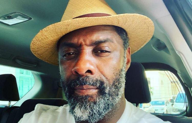 Idris dice que él y su esposa están asintomáticos