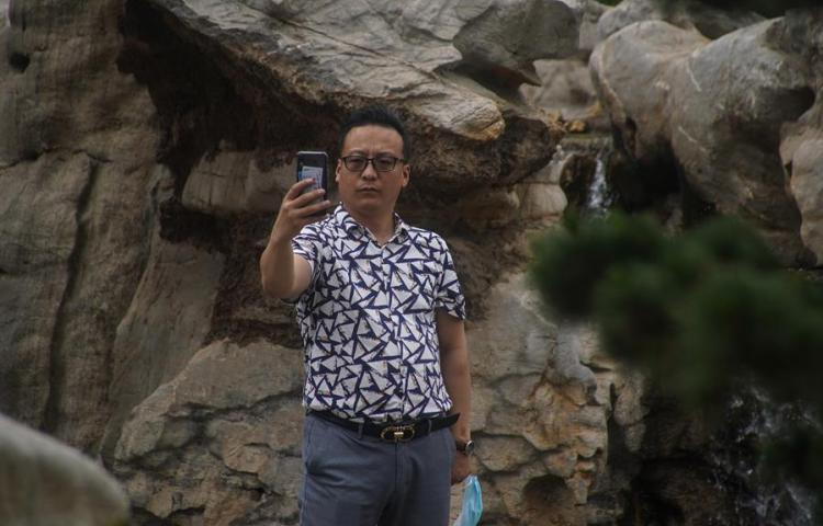 Pekín levanta la obligatoriedad de usar mascarilla en espacios abiertos